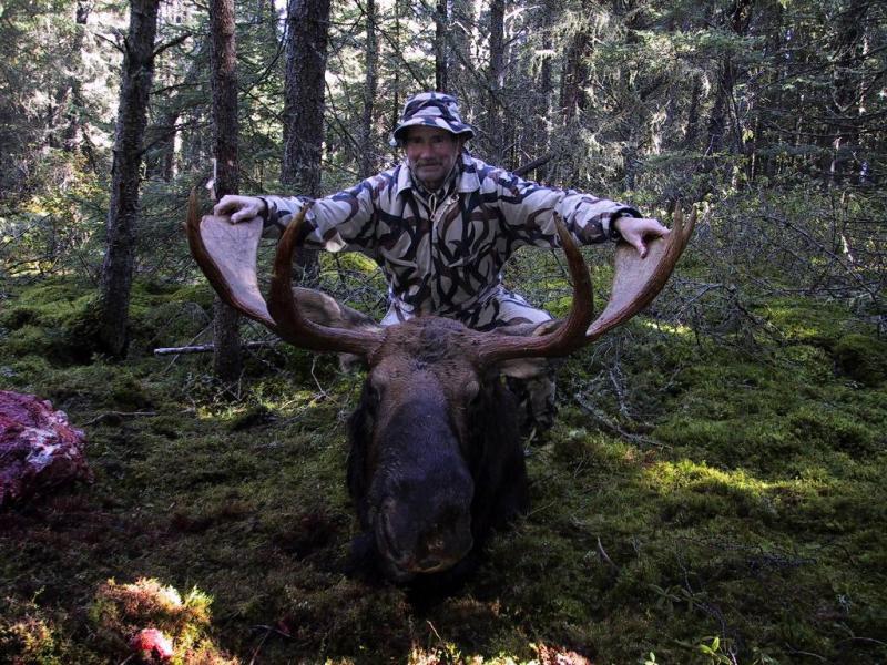 Hunter with Taken 48 Incher Bull