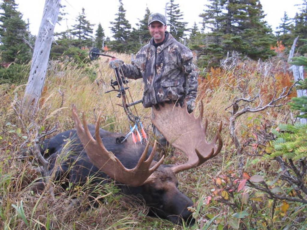 Hunter next to Big Taken Bull