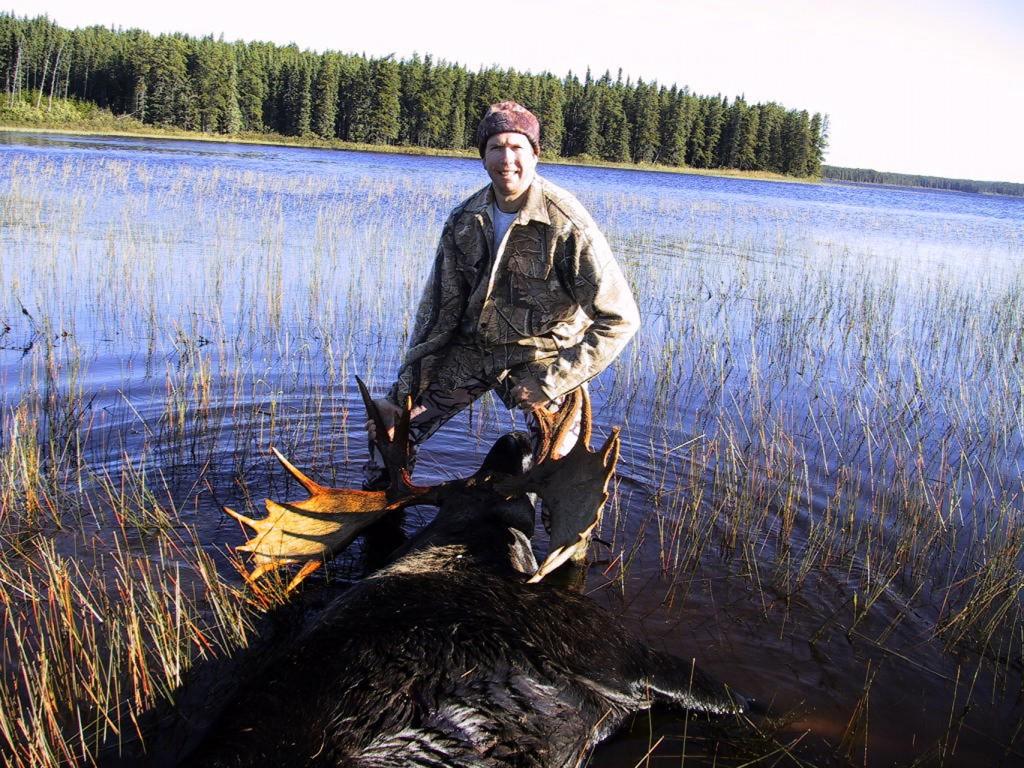 Hunter next to 51 Incher Taken Bull